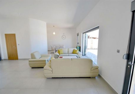 Villa Lule-open plan lounge with sofas and dining area