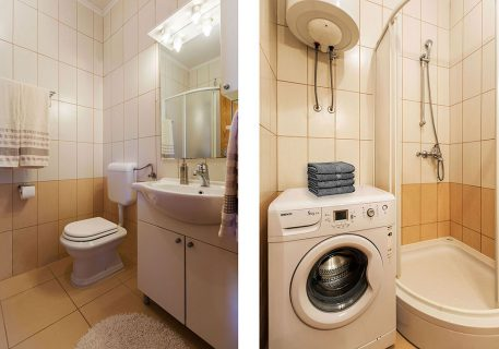 Apartment Alma-family bathroom with shower and washing machine