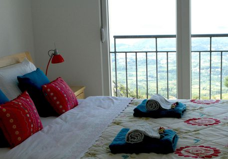Villa Arc-Master bedroom with patio doors opening onto the balcony with view of Dubrovnik Riviera