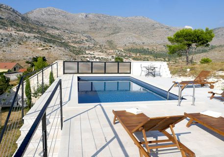 Villa Branko-the pool, sunloungers and mountains as a back drop