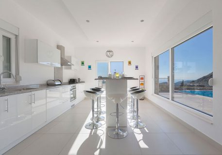 Villa Price-breakfast bar and patio doors opening onto the pool and terrace