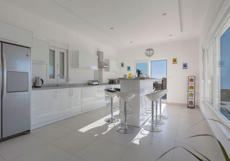 Villa Price-fully fitted kitchen with breakfast bar, fridge and dishwasher