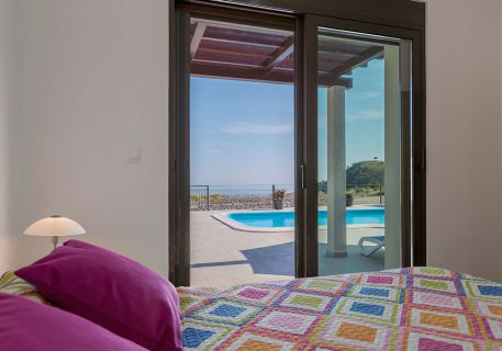 Villa Queen-Master bedroom with the patio doors opening onto the private pool