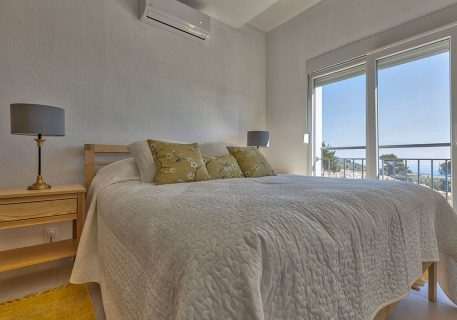 Villa Tamara-Master bedroom with hand crafted bed, quality linen and air-conditioning