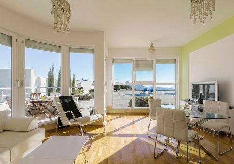 Apartment Lana-the lounge with satellite TV and access to the private terrace and pool