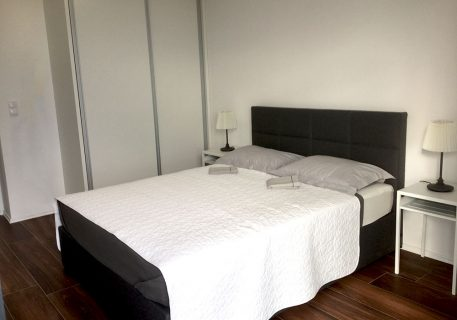 Master bedroom with King-size bed, AC and balcony adjacent to the family bathroom