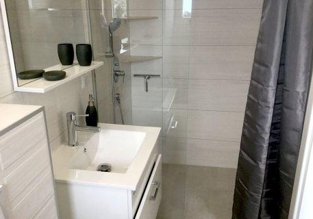 En suite bathroom with walk-in shower to Master bedroom