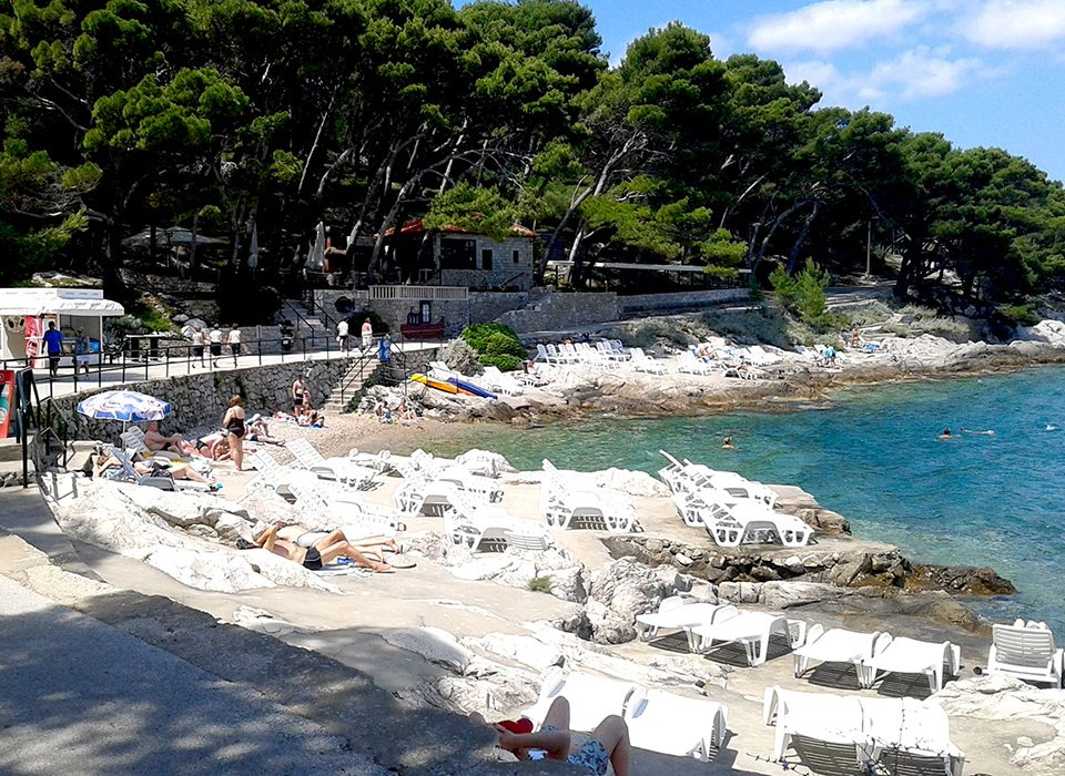 Explore Cavtat-Sunbathing and swimming amongst the craggy rocks