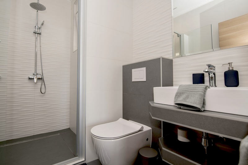 Villa Layla-Adjacent bathroom with large walk-in shower