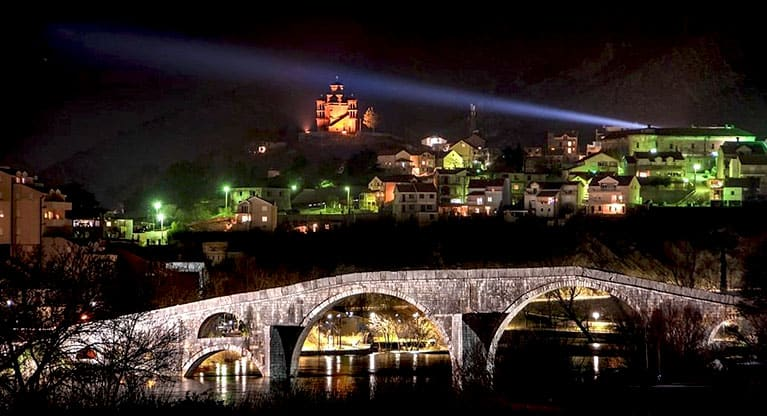 A night time view of the old stone bridge and town-Trebinje