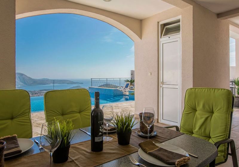 Luxury Apartment Goja-Dinning area with the view to the pool and Dubrovnik Riviera