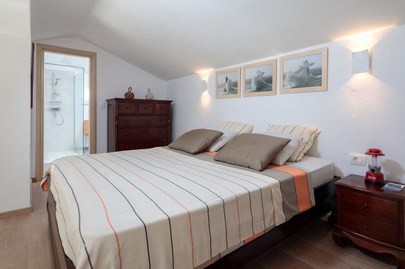 Luxury Villa Zizanj-Secondary master bedroom with king sized bed and en-suite bathroom